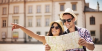 Happy tourist sightseeing city with map - Business-Vector.Info