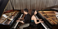 Two people, a couple playing duet musical performance with two g - Business-Vector.Info